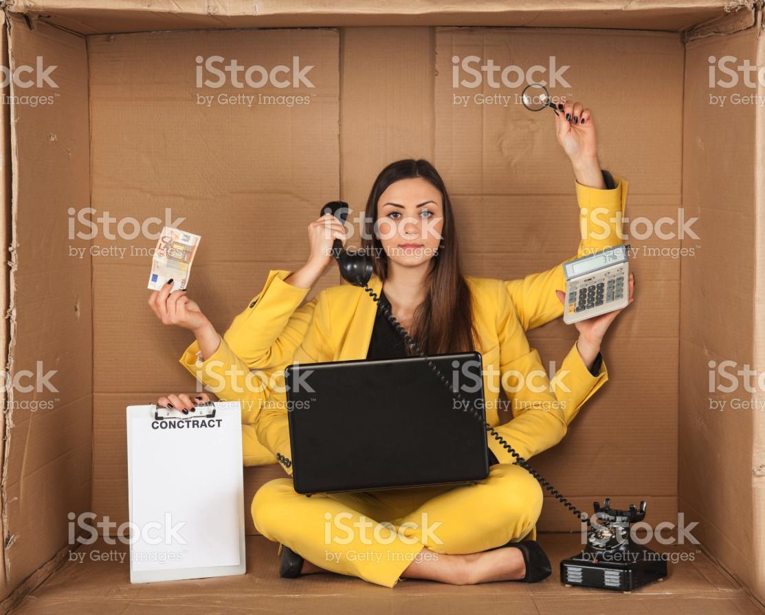funny istock photo woman multitasking